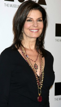 Sela Ward -  cowl neck tops and plunging V necklines